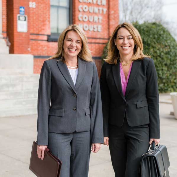 Carolyn-Peacock-and-Karen-Alexander-Family-Law-Attorneys-outside-Craven-County-Courthouse