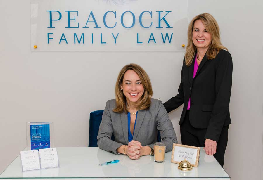 Carolyn-Peacock-and-Karen-Alexander-in-front-of-the-Peacock-Family-Law-sign